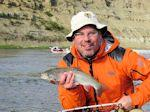 Geoff Badger (AB) with one of the last trout of the day. - Bow River Hookers - Bow River Fly Fishing Guide and Outfitter